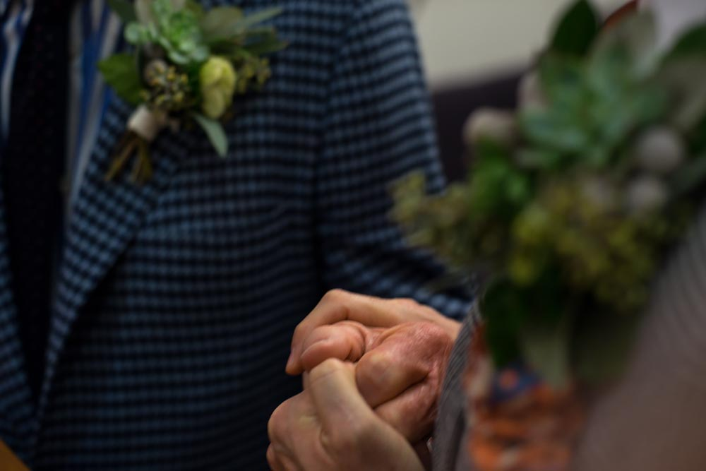 Documentary unique wedding NYC Same Sex Couple emotional holding hands, Steve Giovinco