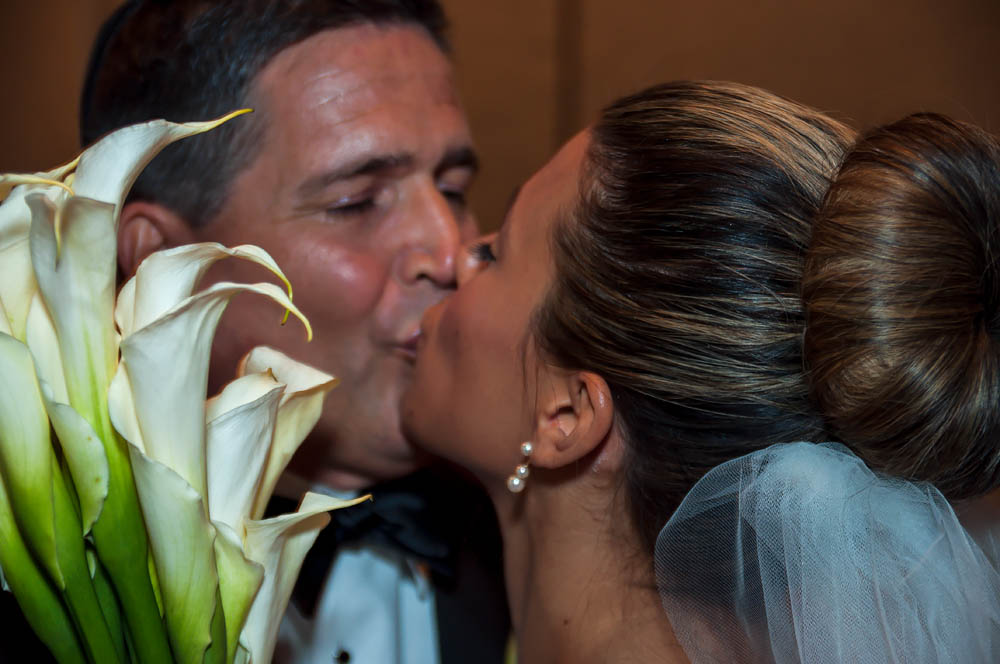 Fine art documentary wedding commission photography in NYC, kissing the bride, Steve Giovinco